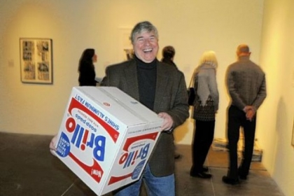Frank Garger with a Brillo box that he bought by artist by Charles Lutz.