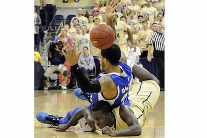 Pitt's Tray Woodall lands underneath Seton Hall's Brian Oliver as the ball bounces on Oliver's head to go out of bounds in the first half Monday night at Petersen Events Center.