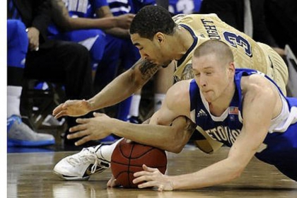 Pitt's Cameron Wright dives for the ball against Seton Hall's Kyle Smyth in the second half at Petersen Events Center.