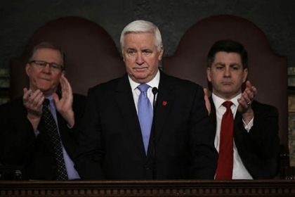 Gov. Tom Corbett delivers his budget proposal today in Harrisburg. Also pictured: Rep. Sam Smith, R-Jefferson (l), and Lt. Gov. Jim Cawley.
