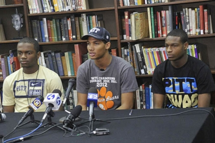 Tyler Boyd, center and his Clairton teammates, Terrish Webb, left, and Titus Howard, right, all plan to sign letters of intent to play football for the University of Pittsburgh.