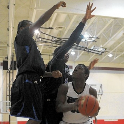 Obama's Lamont Butler, right, waits for an opening to shoot against a Perry double team Tuesday in a City League game.