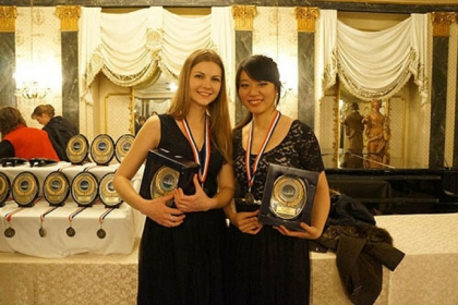 Mary Pappert School of Music students Anna Kovalevska, left, and Yuting Zhou won first place at last month&#039;s 15th annual United States International Duo Piano Competition in Colorado Springs.