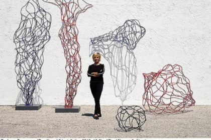 "Barbara Sorensen with her wiry aluminum ""Dwellings V"" installation of 2010. This sculpture is not in the Manchester exhibition but she will talk about it Thursday."