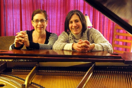 Pianists Tina Faigen and Becky Billock at a practice session.