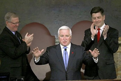 Gov. Tom Corbett, with House Speaker Sam Smith, R-Jefferson, at left, and Lt. Gov. Jim Cawley, right, behind him, arrives Tuesday to deliver his budget proposal for the new fiscal year to a joint session of the Pennsylvania General Assembly.