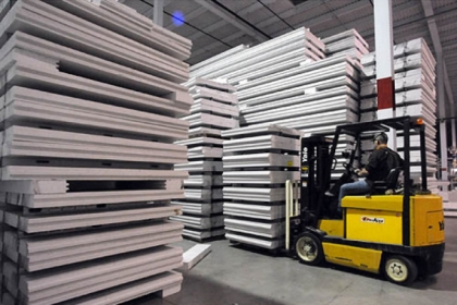 Steel-reinforced cast polystyrene building panels are stacked high at the Syntheon facility in Leetsdale.