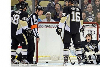 Penguins goalie Marc-Andre Fleury protests a penalty not being called after having his mask knocked off as the Capitals scored 1-0 in the first period.