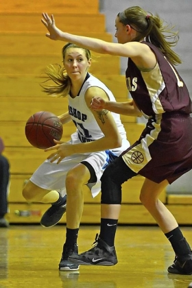 Bishop Canevin's Erin Waskowiak, driving to the basket against Chartiers-Houston, leads the Crusaders in scoring.
