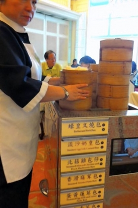 Steamed dumplings are kept hot in carts wheeled from table to table.