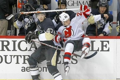 Simon Despres takes New Jersey's David Clarkson into the bench area in the Penguins win against the Devils Saturday at Consol Energy Center. Despres has a plus-minus rating of plus-4 in eight games.