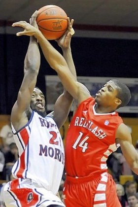 Robert Morris' Lucky Jones takes a foul from Saint Francis' Dom Major in the first half at the Sewall Center Wednesday night.