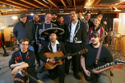 Members of the Amigos Live! band, Guaracha and Miguel&#039;s Mariachi Fiesta gathered at Orion Czarnecki&#039;s Studio O in Beaver Falls for rehearsal. Mr. Czarnecki is in the third row, center.