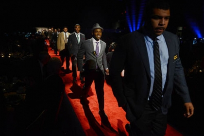 Steelers wide receiver Antonio Brown, second from right, walks the red carpet with fellow athletes.
