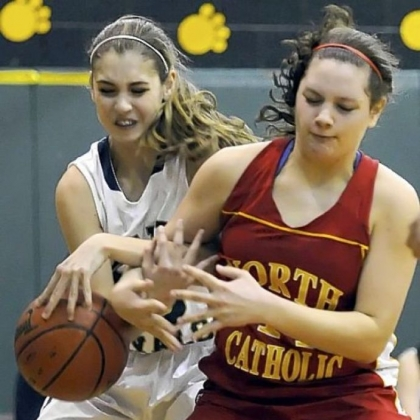 Vincentian Academy's Kiersten Elliott and North Catholic's Abby Goetz fight for the ball Thursday night at Marshall Middle School. Vincentian won, 50-33.