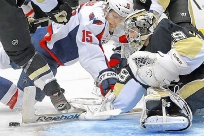 Penguins goalie Marc-Andre Fleury makes a save on the Capitals' Joey Crabb in the second period of Thursday's 5-2 win against Washington.