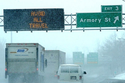Signs on Interstate 291 in Springfield, Mass. warning of dangerous travel today. Massachusetts Gov. Deval Patrick declared a state of emergency and banned travel.