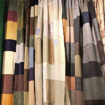 Design Legacy&#039;s Goods Made Good line of drapes created from material donated to Goodwill. Men&#039;s suiting fabric and corduroy patches are shown.