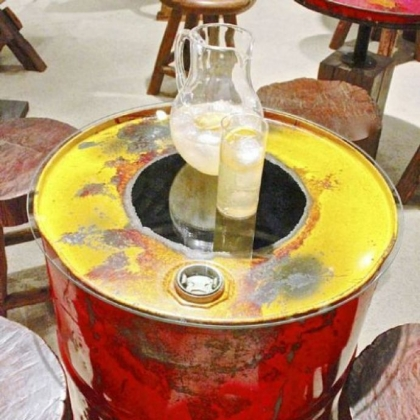 Reclaimed steel drum side table with glass top  by Groovystuff.