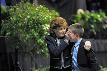 "Sue Paterno wipes tears from the face of one of her grandchildren as they leave ""A Memorial for Joe"" last January at the Bryce Jordan Center on the campus of Penn State University."