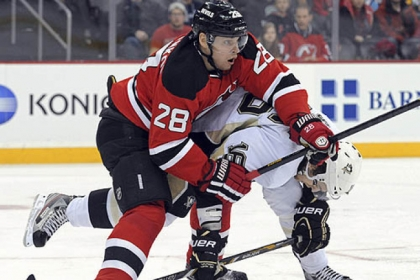 The New Jersey Devils' Anton Volchenkov checks the  Penguins' Brandon Sutter during the first period of this afternoon's game in Newark.
