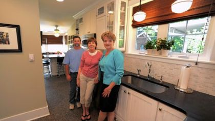 Contractor Scott Bissell of Bissell Contracting, Patty Schlicht and designer Dawn Day in the narrow renovated kitchen at Ms. Schlicht's Squirrel Hill home.