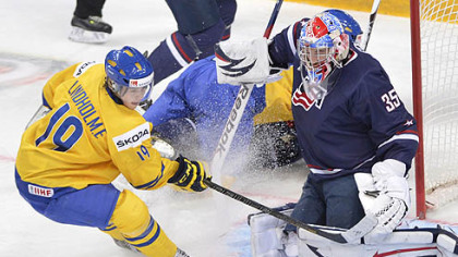 Team USA goaltender John Gibson makes a save off Sweden's Elias Lindholm during first period gold medal hockey action at the IIHF World Junior Championships in Ufa, Russia today.