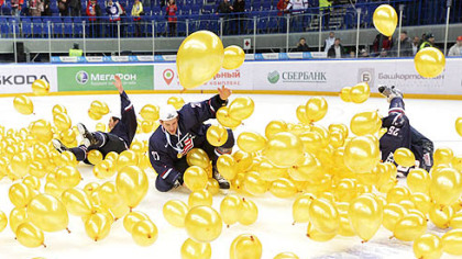Team USA celebrates in balloons on the ice after defeating Sweden for the gold medal at the IIHF World Junior Championships in Ufa, Russia, today.