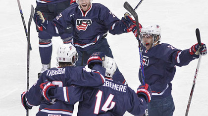 Team USA's Rocco Grimaldi, top celebrates his second goal against Sweden with teammates, from left, Jacob Trouba, Shayne Gostisbehere and Vince Trocheck during second period gold medal hockey action at the IIHF World Junior Championships in Ufa, Russia,today.