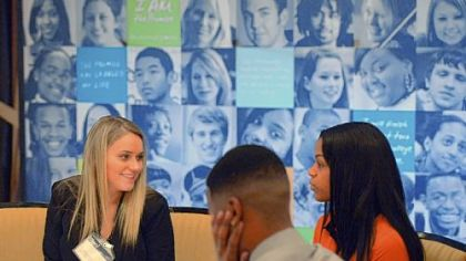 Melissa Walsh, left, 20, of Brookline conducts a mock interview with Phill Ross, 20, of Beltzhoover and Dana King, 20, of Pittsburgh during the Pittsburgh Promise career training workshop at the Rivers Club, Downtown, on Friday.