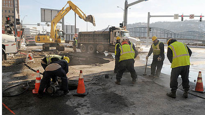 Work crews Thursday afternoon at the intersection of Wood Street and Fort Pitt Boulevard.