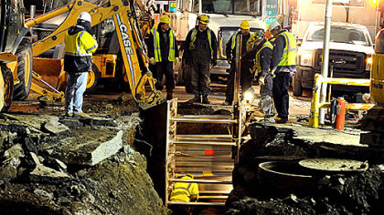Work continues early Friday morning at scene of yesterday's major water main break at the intersection of Fort Pitt Boulevard and Wood Street.