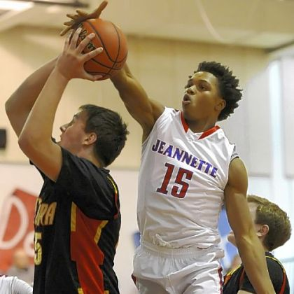 Jeannette's Damone Morton blocks a shot by Serra Catholic's George Prota Friday.