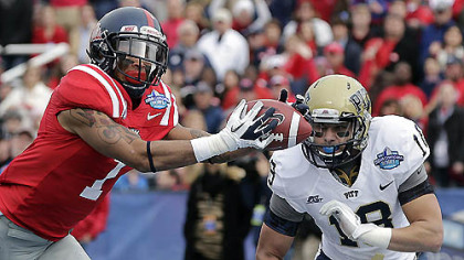 Mississippi receiver Randall Mackey catches a touchdown pass as Pitt's Jarred Holley defends during the first quarter of today's BBVA Compass Bowl game underway at this hour at Legion Field in Birmingham.