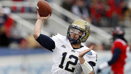 Pitt quarterback Tino Sunseri warms up today before the BBVA Compass Bowl NCAA college football game against Mississippi now underway at Legion Field in Birmingham.