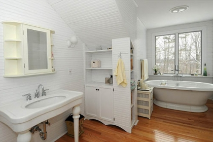 The master bathroom was completely rehabbed by the present owner and includes an oversized shower and a heated towel rack.