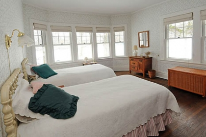 The first-floor bedroom shows off the fine hardwood floors that run throughout the house.
