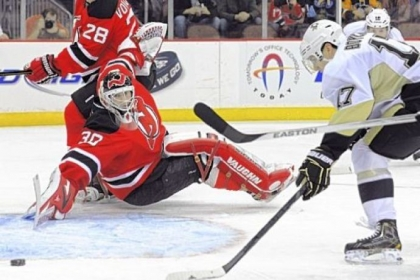 Martin Brodeur reaches back to make one of his 24 saves.