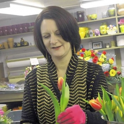 Carmel Vandale assembles arrangements in her floral shop in Mt. Lebanon.