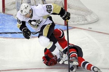 Tyler Kennedy clears a fallen Stephen Gionta in the Penguins' 3-1 loss to New Jersey Saturday.