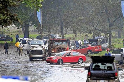 Aug. 19, 2011: Cars strewn on Washington Boulevard after storms brought heavy rains and street flooding. Four people died.