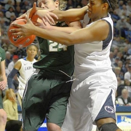 Penn State's Talia East, right, reaches past Michigan State's Courtney Schiffauer for a rebound in the first half Sunday in University Park, Pa.