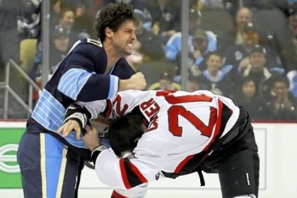 The Penguins' Robert Bortuzzo, left, fights the Devils' Ryan Carter on the opening faceoff.
