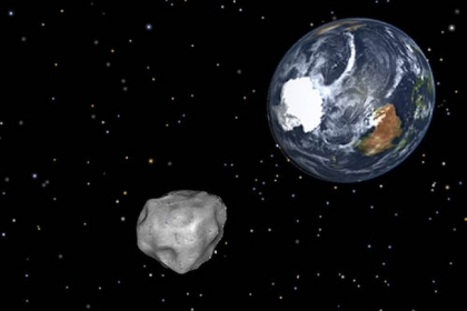 A simulation of asteroid 2012 DA14 approaching as it passes through the Earth-moon system this Friday.