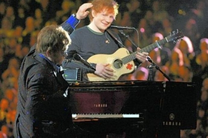 Sir Elton John, left, and Ed Sheeran perform on stage at the 55th annual Grammy Awards.