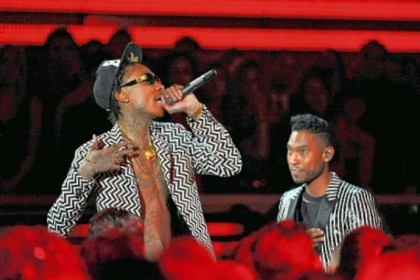 Musicians Wiz Khalifa, left, and Miguel perform at the 55th annual Grammy Awards.