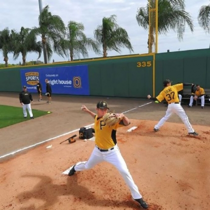 Right-hander Gerrit Cole, left, in 2012 warms up in the bullpen with Jeff Locke at McKechnie Field at Pirate City in Bradenton, Fla.