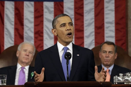 President Barack Obama, flanked by Vice President Joe Biden and House Speaker John Boehner of Ohio, gives his State of the Union address during a joint session of Congress on Capitol Hill in Washington.