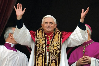 Pope Benedict XVI greeting the crowd from the central balcony of St. Peter&#039;s Basilica moments after being elected in 2005.