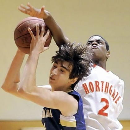 Vincentian Academy's Tony DiNardo grabs a rebound against Northgate's Darrell Barron Monday.